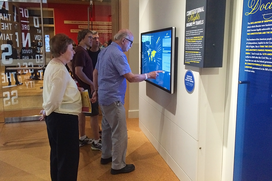Museum visitors explore the rights interactive feature in the George H.W. Bush Gallery.